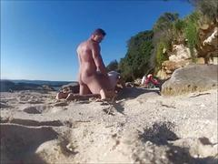 Secretly fucking my wife at the nude beach