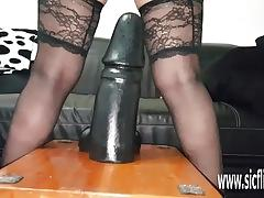 Huge dildos stretch her insatiable loose pussy