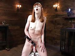 Erotic babe gets pounded in her tight pussy via fuck machine