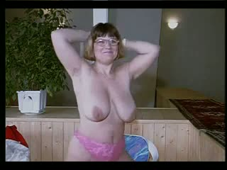 Chubby amateur woman with glass and big tits stripping