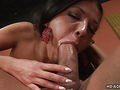 Dark haired slut sucks cock insanely