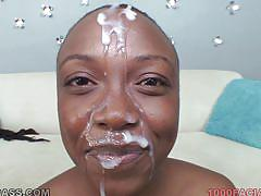 Black blowjob queen receives a huge load on her face