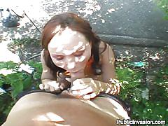 Blowjob under a tree on sunny day