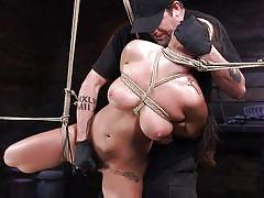 Her body shivers in pain but the master continues his job