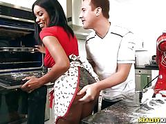 Ebony hottie is sucking cock and cooking in the kitchen