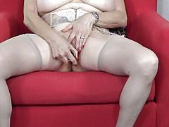 Redhead mature masturbates with sex toys