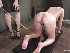 Slave has to take her torture by caning