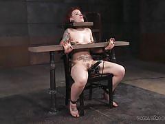 Looks like she sits at a school desk