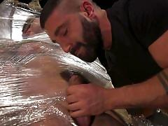 Hard dick wrapped in plastic