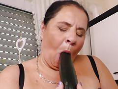 Busty mature masturbates in the kitchen