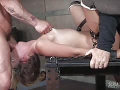 Subservient slave tied up and spitroasted by her masters