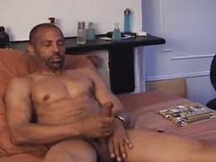 Super hot black daddy strips off and jerks his monster black cock
