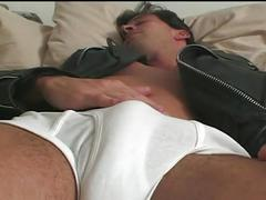 Horny sexy muscled stud in leather jacket sizzling hot solo fun