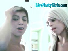 Two hot lesbians lick and play on webcam