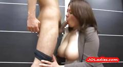 Busty office lady giving blowjob on her knees cum to...