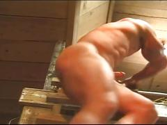 Hot muscled hunk jerking off on the barn