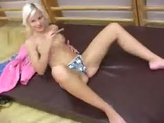 Petite blonde cutie plugging a small dildo in her pussy