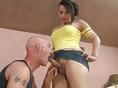 Gaby's cock comes out of her mini skirt