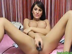 Brunette girl sucking and fucking herself with a black dildo3.w