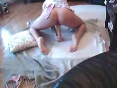 Horny girl toys her pussy on the floor