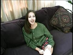 Sexy young brunette fingers her shaved pussy on a couch then fucks