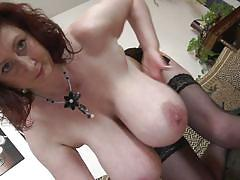 Redhead shows off her saggy tits
