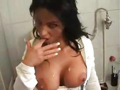 Woman sucks cock while sitting on toilet