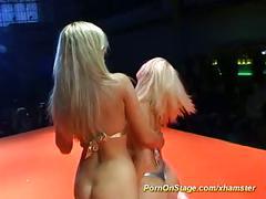 Lesbian orgasm on public show stage