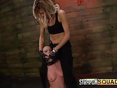 Blindfolded slave has her pussy stretched
