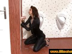 Tall brunette sucking at the gloryhole
