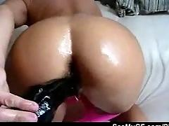 Amateur girlfriend toying her ass with a huge black dildo