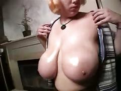Big breasted blond girl shows her big ones