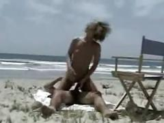 Nude beach - perky little tits blond is loving it