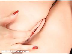 Thick assed redhead filling her wet pussy with a brutal dildo