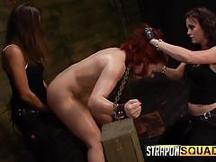 Redheaded slut takes strap on abuse