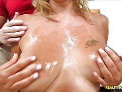 Blonde mom with big tits giving blowjob to a young stud