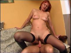 Redhead milf in stockings and boots fucks