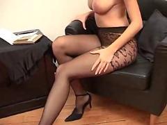 Busty milf puts on pantyhose