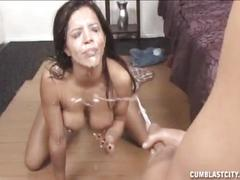 Naked hottie gets a facial cumshot