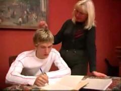 Mature teacher gives boy a private lesson