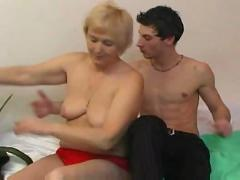 Granny having fun with young lover while smoking