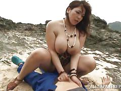 Tit fucking on the rocks