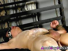 Sucking hard on the waxed cock