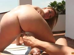 Sexy blonde sucks cock in the balcony
