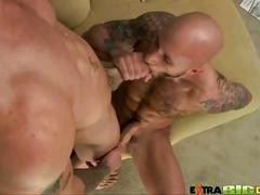 Lewd cock riding tattooed muscled studs