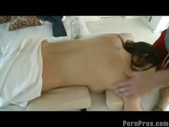 Fondling sexy brunette during massage.