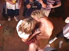 A hot girl doing hardcore sex with a muscled dude in a sex party.
