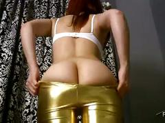 Solo hot girl in gold spandex shiny leggings