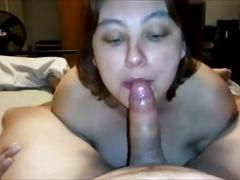 Big titted amateur takes his cock in her mouth