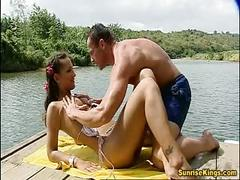 Outdoor bikini babe fucks and eats cum